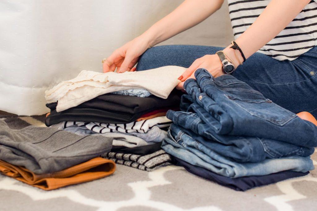 A person folding laundry