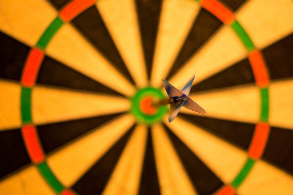 A dart hitting the target
