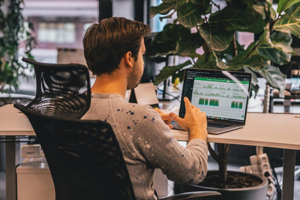 Man using DeskTime to check productivity levels during asynchronous work day