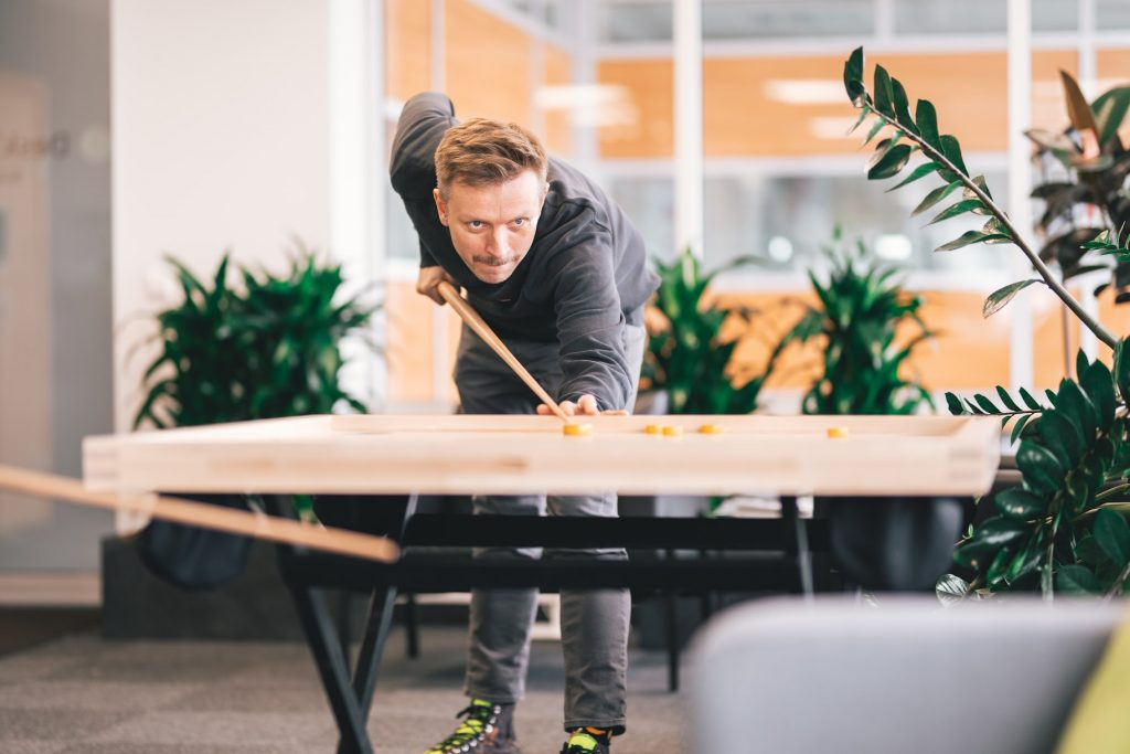 Office worker playing novuss at work