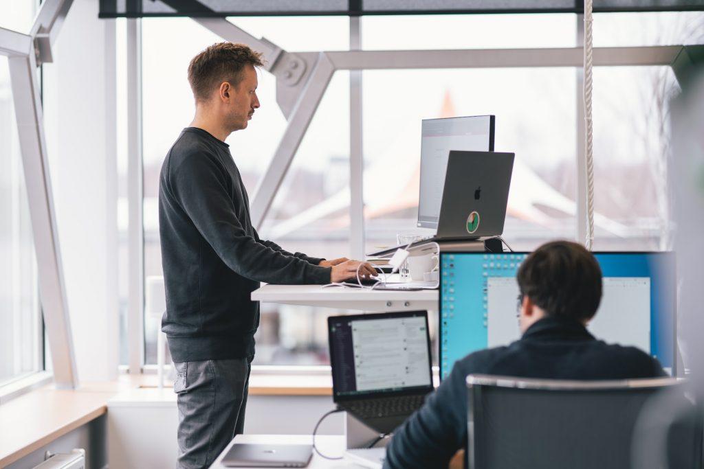 Man using a standing desk